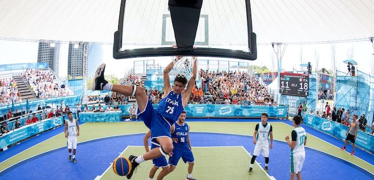 man dunking basketball